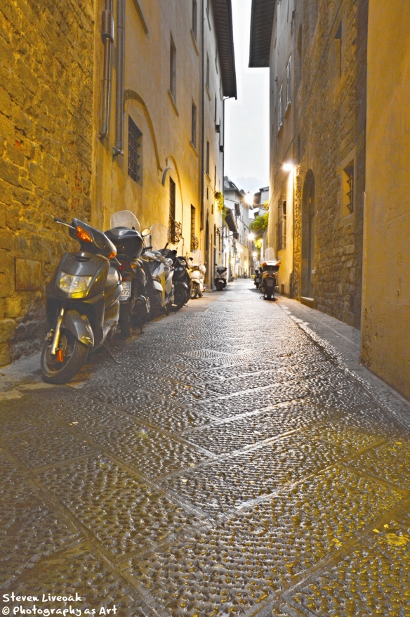 Scooters on a Narrow Street